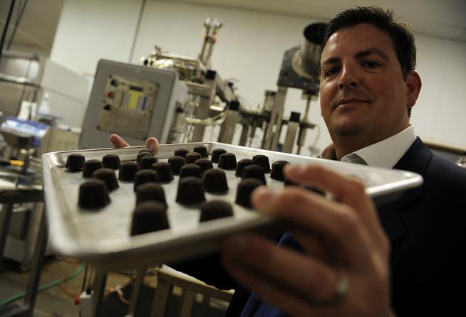 Dixie Elixirs' managing director Tripp Keber runs the Denver-based marijuana company that produces infused edibles, beverages and salves. (RJ Sangosti, The Denver Post)
