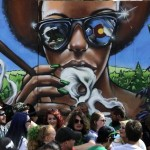 Attendees at Denver's 4/20 rally in the Civic Center congregate by a mural on April 20, 2014. (Seth McConnell, The Denver Post)