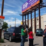 Mason Tvert, right,  spokesman for the Marijuana Policy Project, talks to reporters while standing near a billboard that was supposed to feature a marijuana ad on Wednesday, Sept. 17, 2014. (John Ingold, The Denver Post)