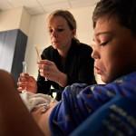 Ana Watson gives her son Preston Raynor cannabidiol oil in the recovery room at Children's Hospital Colorado in Aurora on Sept. 15, 2014. The family came to Colorado seeking treatment for Preston's seizures. (Joe Amon, The Denver Post)