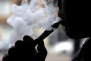 An e-cigarette is demonstrated at a vape store in Chicago. (Nam Y. Huh, Associated Press file)