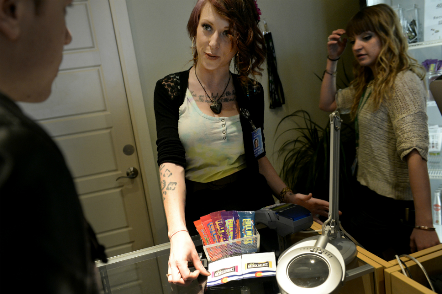Budtender Rosalee Roehling, center, talks about edibles with a customer at LivWell's Broadway location in Denver, Colo. (Craig F. Walker, The Denver Post)