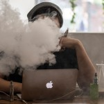 A man puffs in the Vape Lab coffee bar in London on Aug. 27, 2014. (Dan Kitwood, Getty Images)
