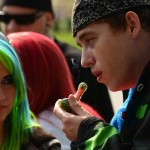 Two attendees partake during the annual 4/20 celebration in Lincoln Park near the State Capitol in Denver on April 20, 2015. (Helen H. Richardson, Denver Post file)