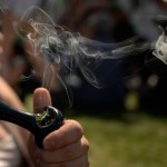A man tokes at the 420 celebration at Denver's Civic Center Park on April 20, 2014. (Joe Amon, Denver Post file)
