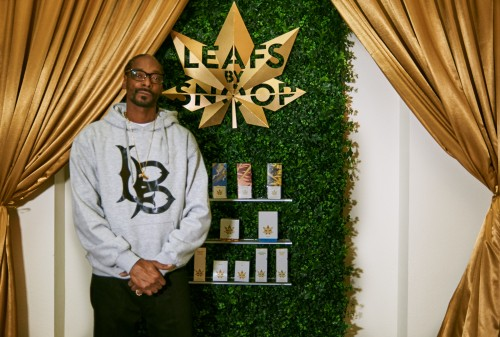 Rapper and entrepreneur Snoop Dogg packs bowls of his new Leafs By Snoop marijuana flower for VIPs at the new cannabis brand's extravagant launch party on Nov. 9 in Colorado. (Leafs By Snoop)