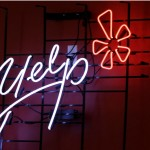 In this Oct. 26, 2011 file photo, the logo of the online reviews website Yelp is shown in neon on a wall at the company's Manhattan offices in New York. (Kathy Willens, AP file)