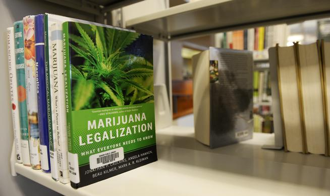 The Denver Public Library is a good resource for books on marijuana. At the Central Library in downtown Denver several books were photographed on the shelf on Dec. 28, 2015. (Cyrus McCrimmon, The Denver Post)