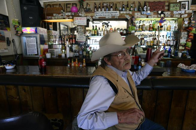 Rex Steiner, 71, sits at the bar at the Highline Cafe & Saloon in Hartsel, Colorado on December 2, 2015. Steiner has lived in the area since 1990. He says he didn't personally know shooter Robert Lewis Dear who lived in the area. (Helen H. Richardson, The Denver Post)